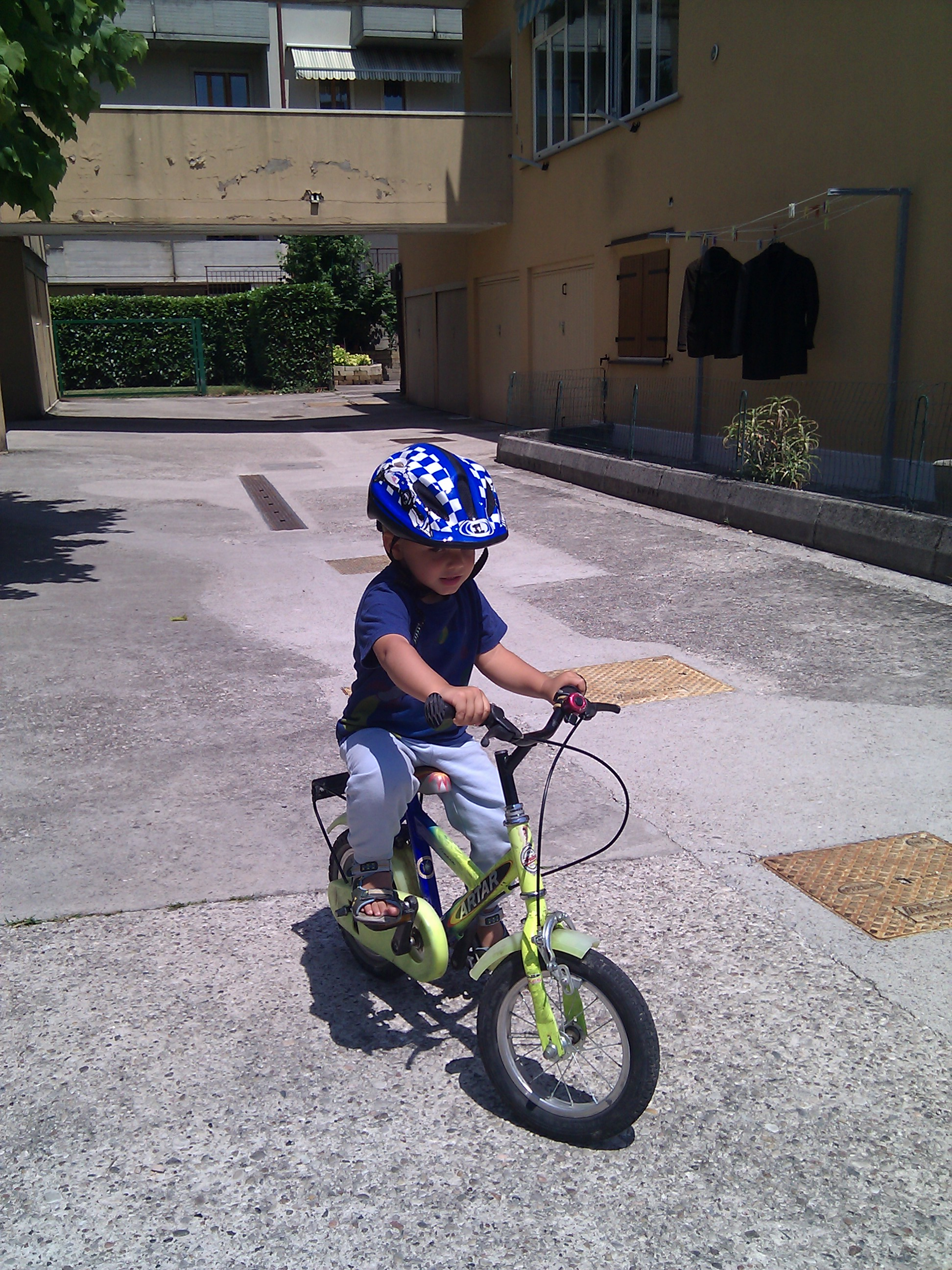 Massimo, still 2, on his bike without traing wheels
